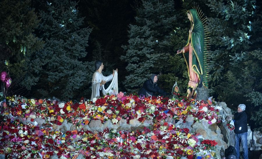 Many worshippers bring flowers to the Shrine of Our Lady of Guadalupe in Des Plaines, where a 12-foot tall replica statue of Our Lady of Guadalupe sits. Catholics believe Mary spoke to Juan Diego, a Mexican peasant, on Dec. 12, 1531, on a hill outside Mexico City.