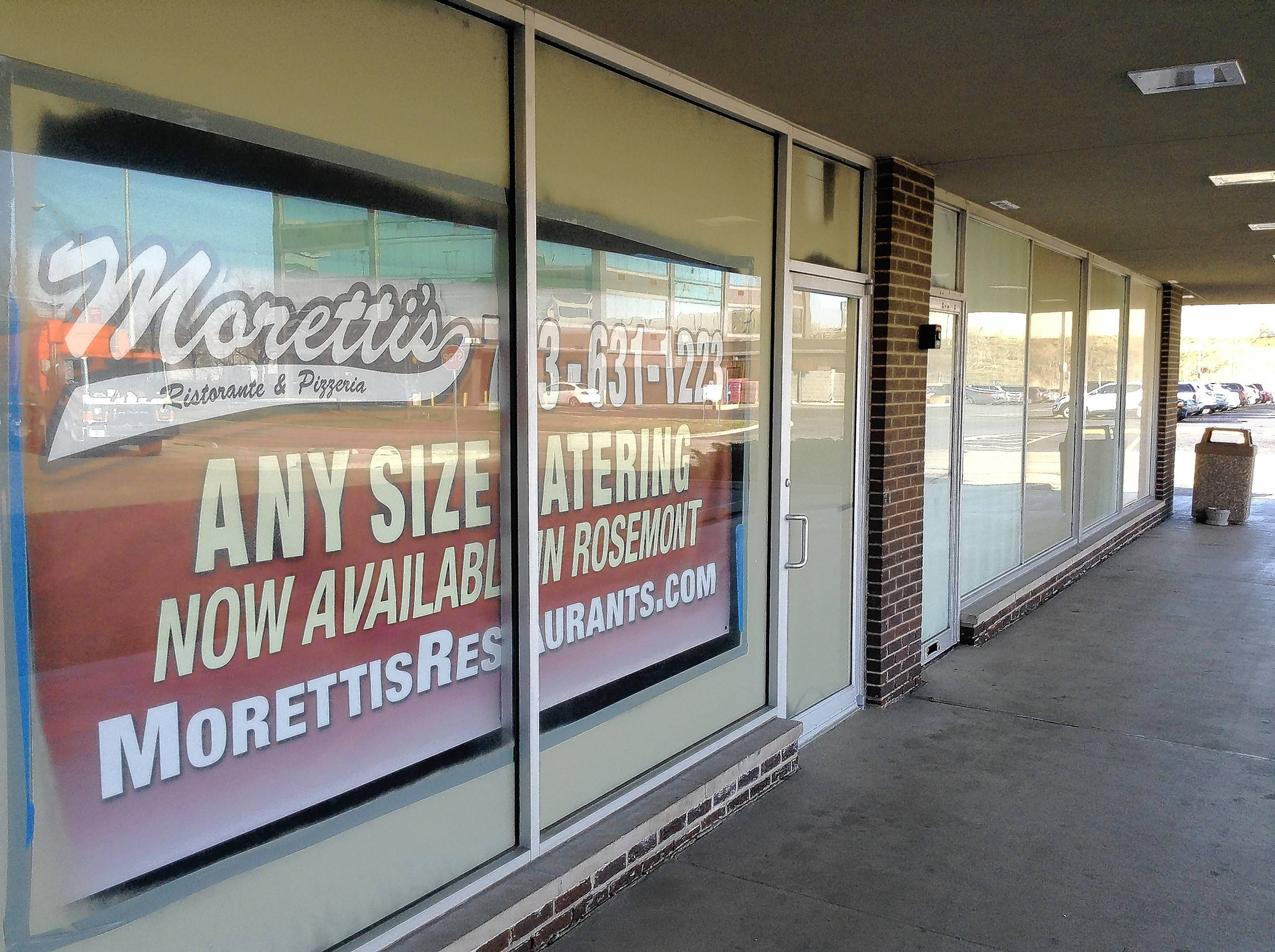 A sign hangs in the windows of a planned Moretti's restaurant at a Higgins Road strip mall in Rosemont. The village agreed Wednesday to give the restaurant's owners $500,000 to help get it open by next summer.