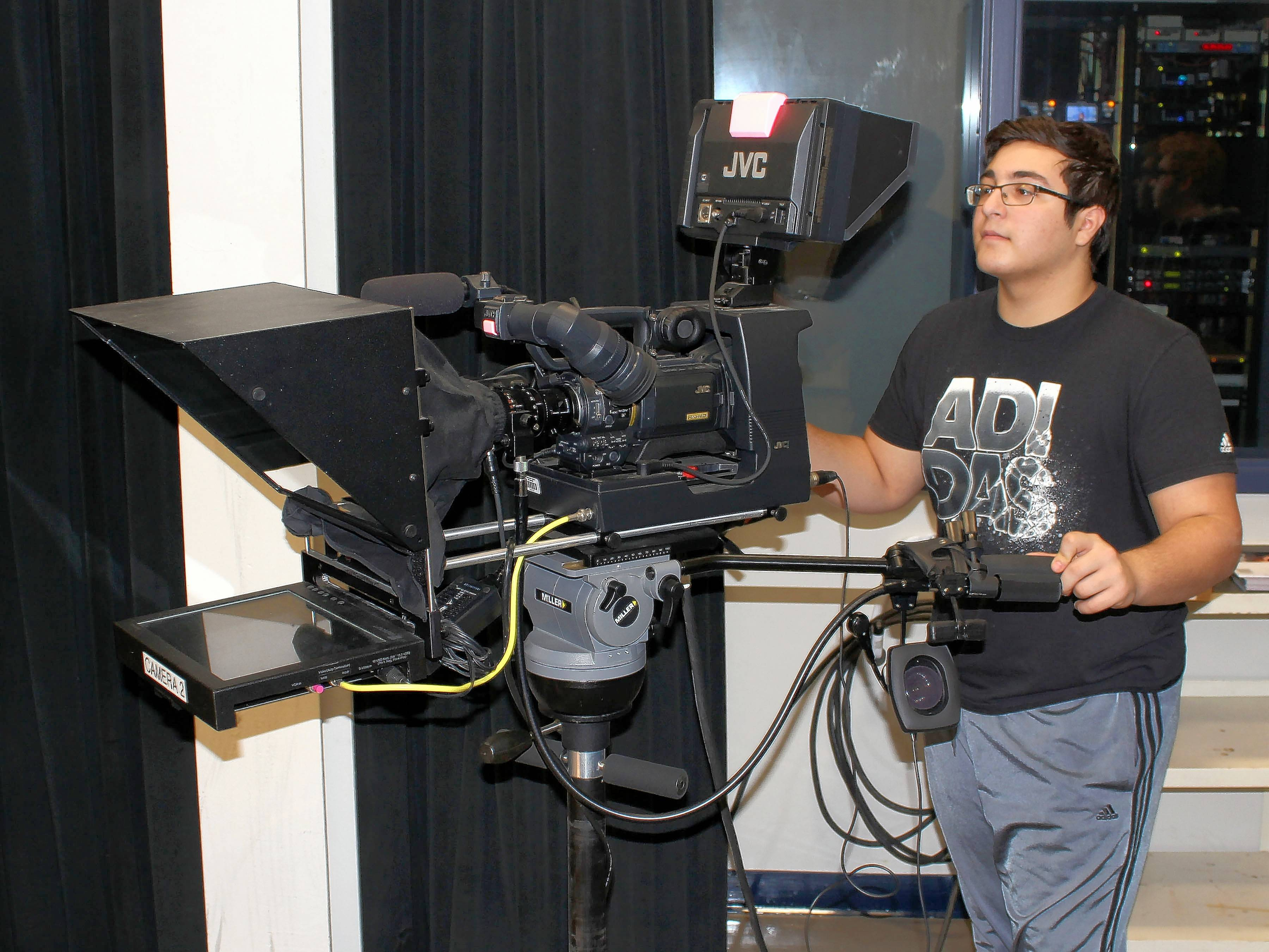 Richie Schumann, a senior from Downers Grove South, operates one of TCD's HD television cameras, which includes a teleprompter.