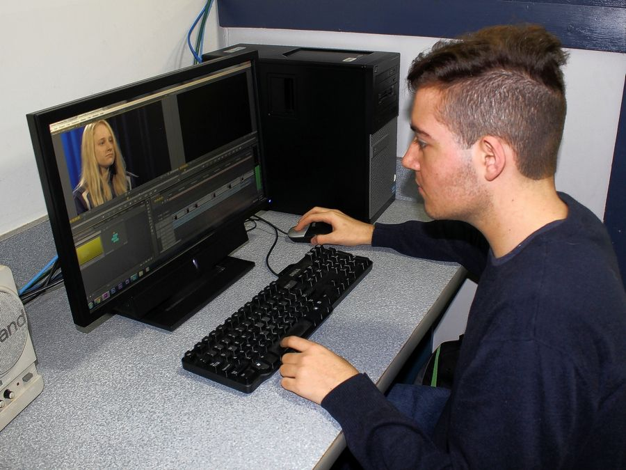 Nicholas Scurto, a senior from Hinsdale Central, edits a student interview using Adobe Premiere. The interview is part of a larger project highlighting TCD's welding program.