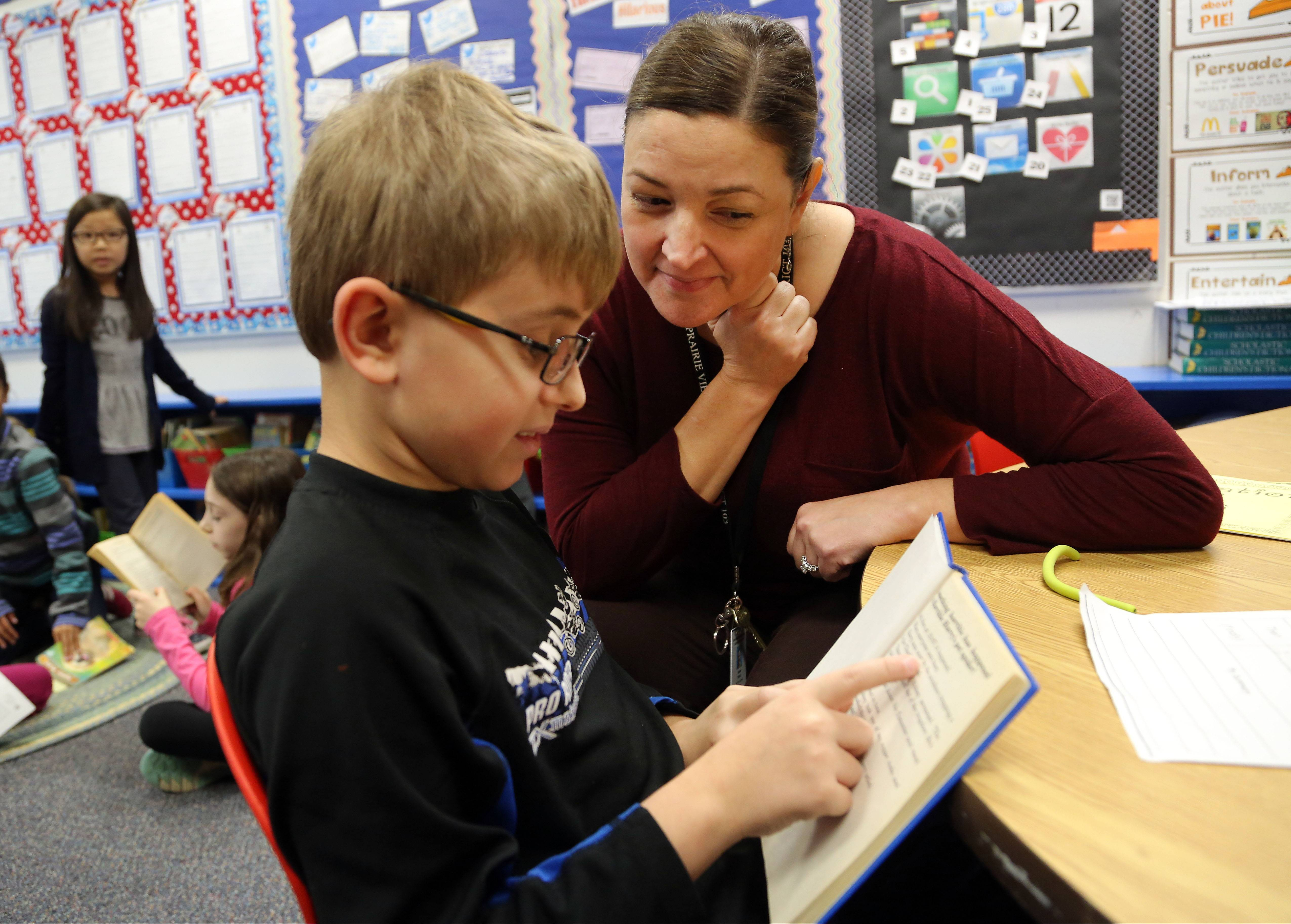 Third-grade teacher Susan Walsh, right, works with Nick Zizzo at Half Day School in Lincolnshire. Half Day was among the top performing elementary and middle schools in Lake County on Illinois' new standardized test.