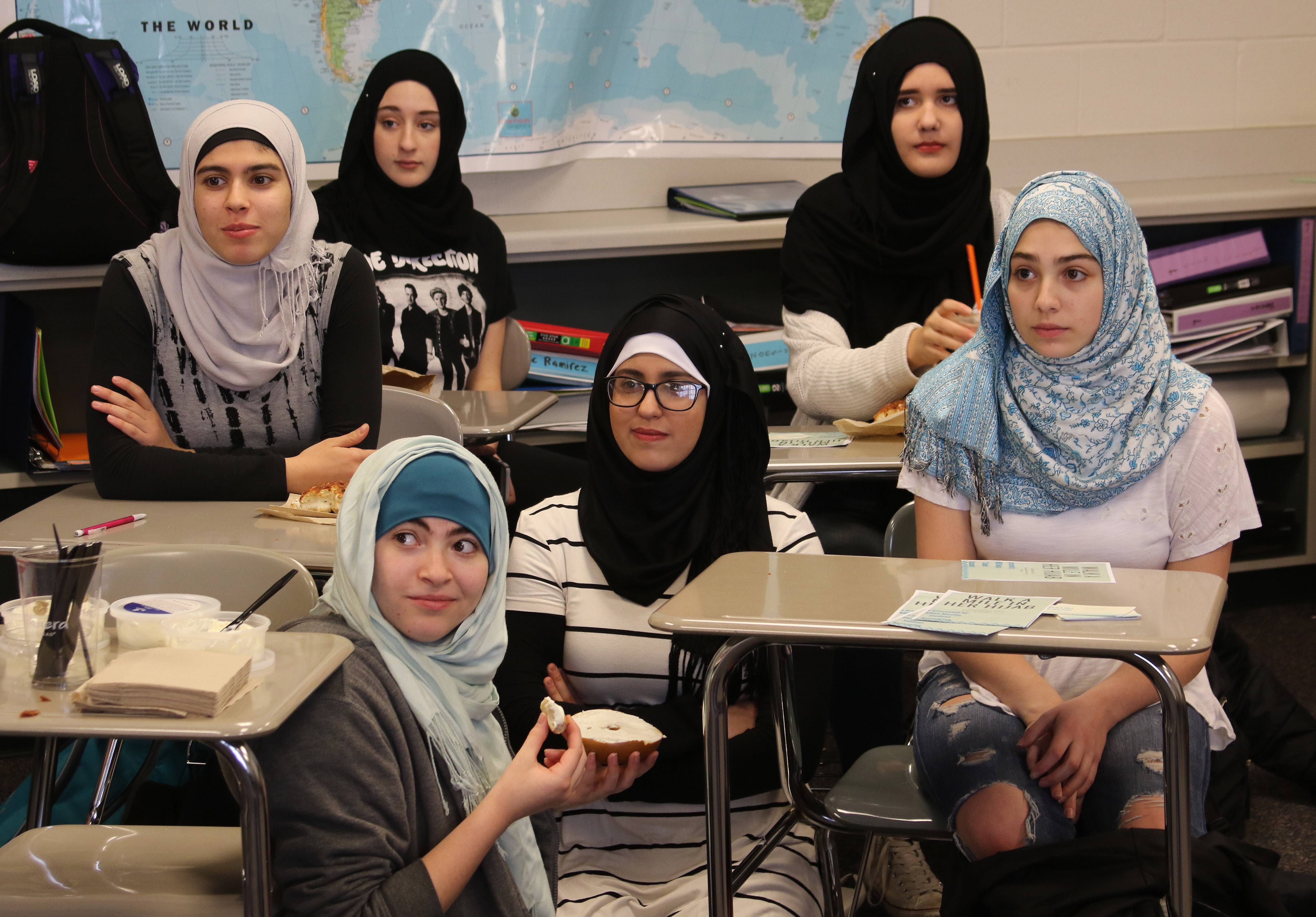 "Muslim and non-Muslim girls at Vernon Hills High School wear hijabs Wednesday during the ""Walk a Mile in Her Hijab"" event. The program was organized to promote awareness of the Muslim faith."