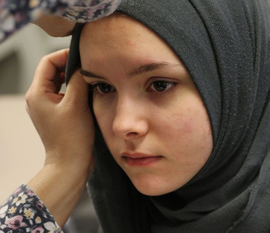 "Vernon Hills High School student Brie Poitra wears a hijab during the ""Walk a Mile in Her Hijab"" event Wednesday at the school. The program was sponsored by the school's Muslim Student Association to promote awareness of the Muslim faith."
