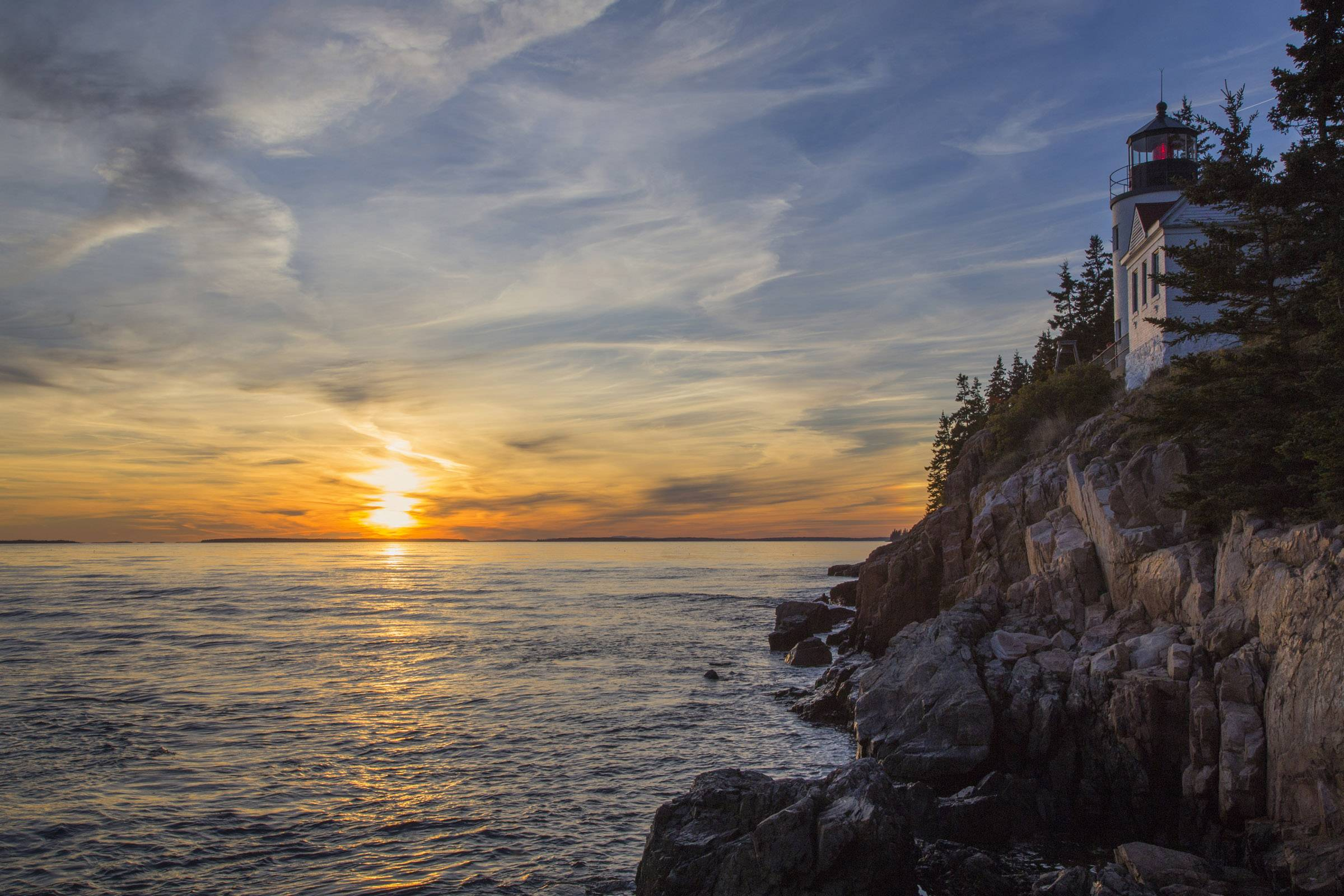 The sun sets at Bass Harbor Lighthouse in Acadia National Park just prior to sunset on Sunday, October 4. The lighthouse is a popular tourist attraction.