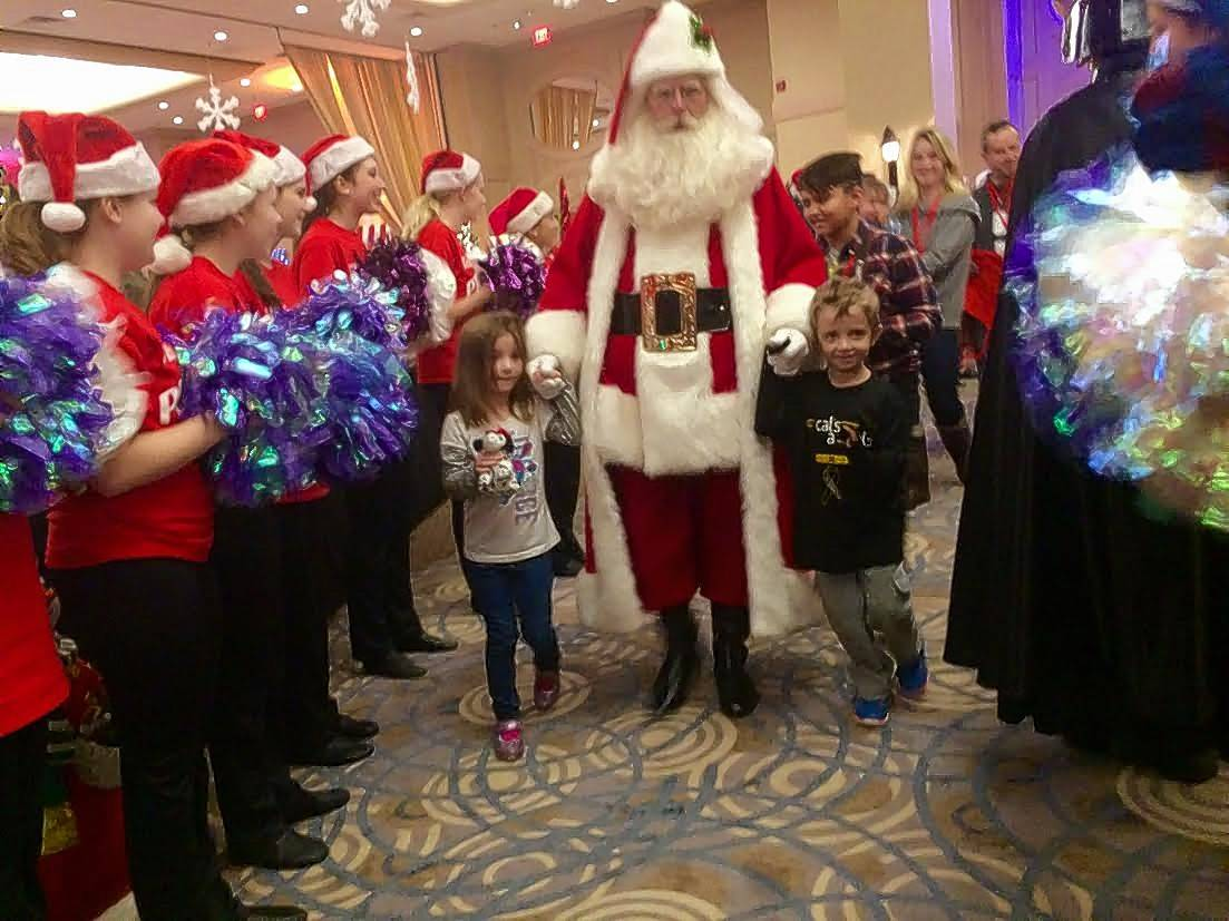 Santa leads the way Saturday as children and their families arrive at the Donald E. Stephens Convention Center in Rosemont for Operation North Pole, a Christmas party for severely ill children.