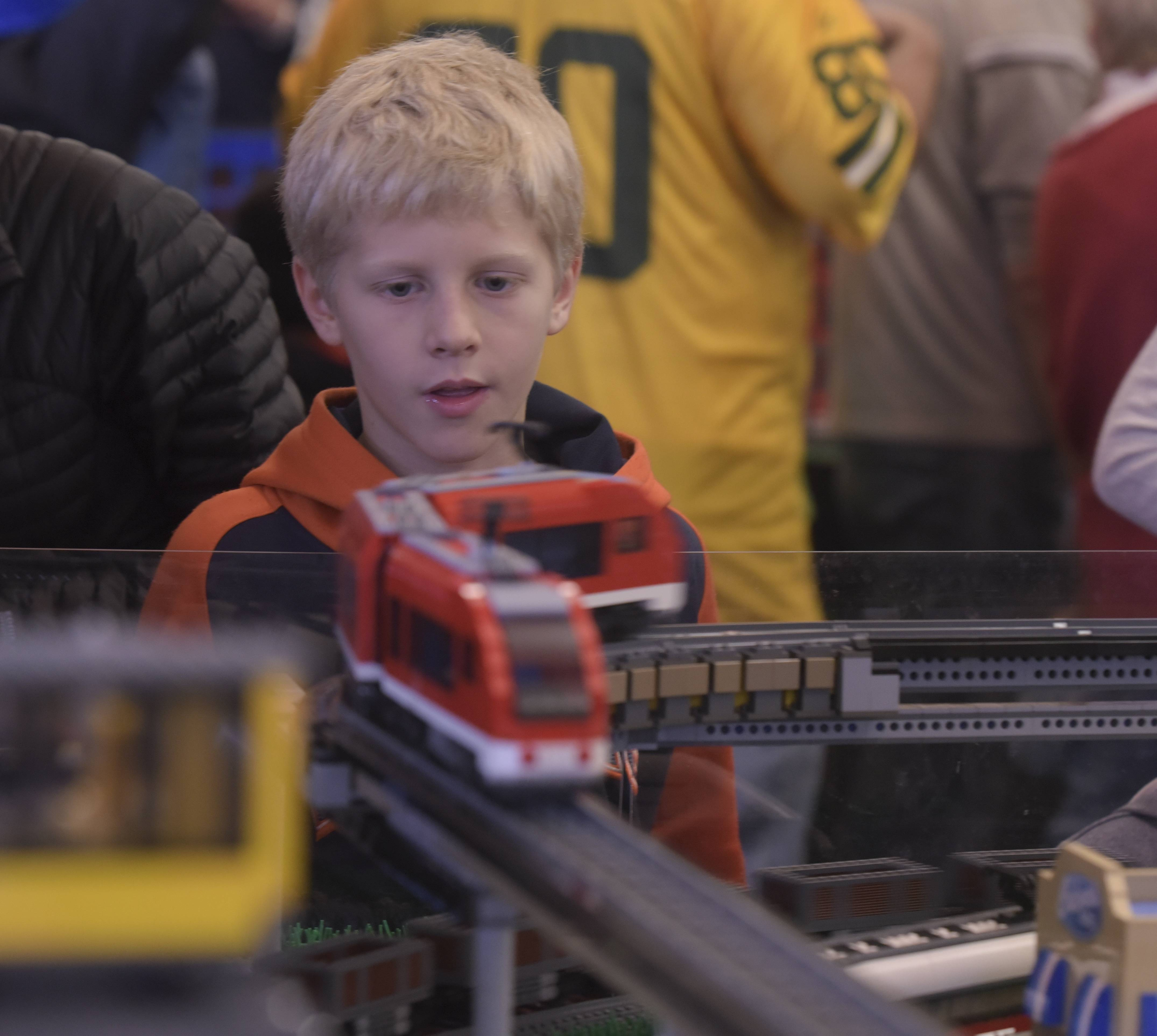 Billy Brouwer, 10, of Naperville checks out a Lego creation Sunday at the 14th annual Lego Train Show at Cantigny Park. The huge Lego displays were created by members of the Northern Illinois Lego Train Club.