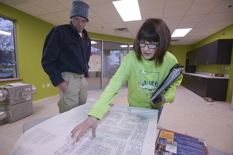 Construction Supervisor Russ Hager and Executive Director and co-founder Deanna Tyrpak look over the blueprints for the new Soaring Eagle Academy building, scheduled to open next month at 800 Parkview Blvd. in Lombard. Soaring Eagle has been serving students with autism since 2010, when it opened in Burr Ridge.
