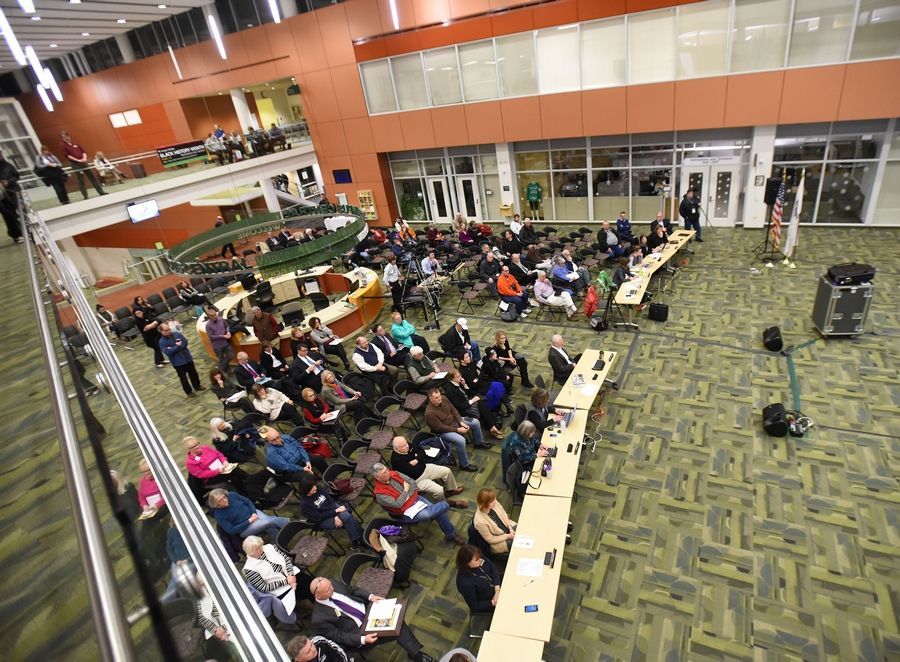 The people attending Thursday's meeting at the College of DuPage included faculty members who decried the school's probation status.