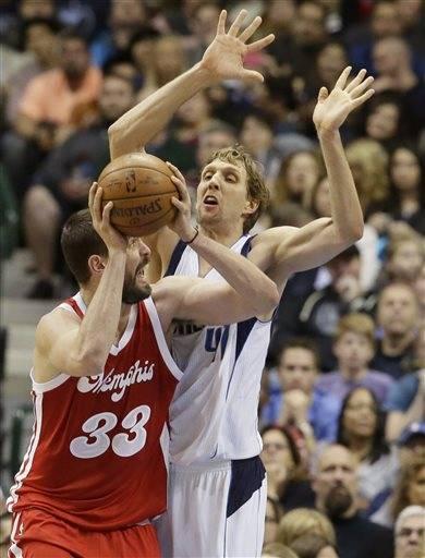 1bd283099 Memphis Grizzlies center Marc Gasol (33) is defended by Dallas Mavericks  forward Dirk Nowitzki