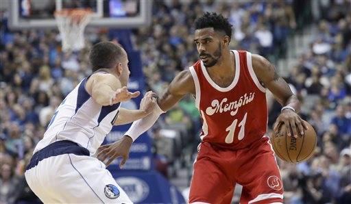 ca3cf86d2 Memphis Grizzlies guard Mike Conley (11) dribbles against Dallas Mavericks  guard J.J. Barea (