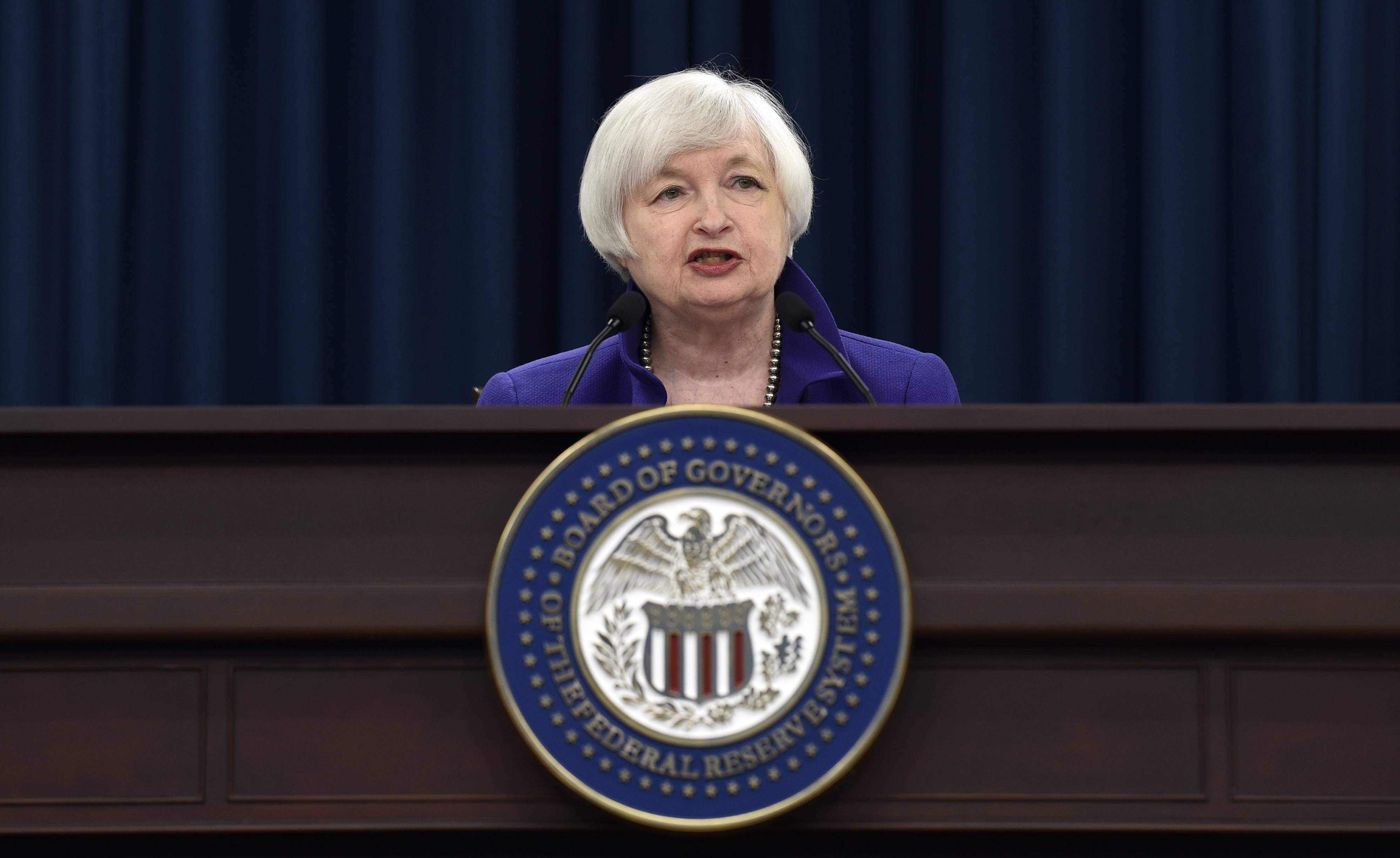 Federal Reserve Chair Janet Yellen speaks Wednesday during a news conference in Washington following an announcement that the Federal Reserve raised its key interest rate by quarter-point, heralding higher lending rates in an economy much sturdier than the one the Fed helped rescue in 2008.