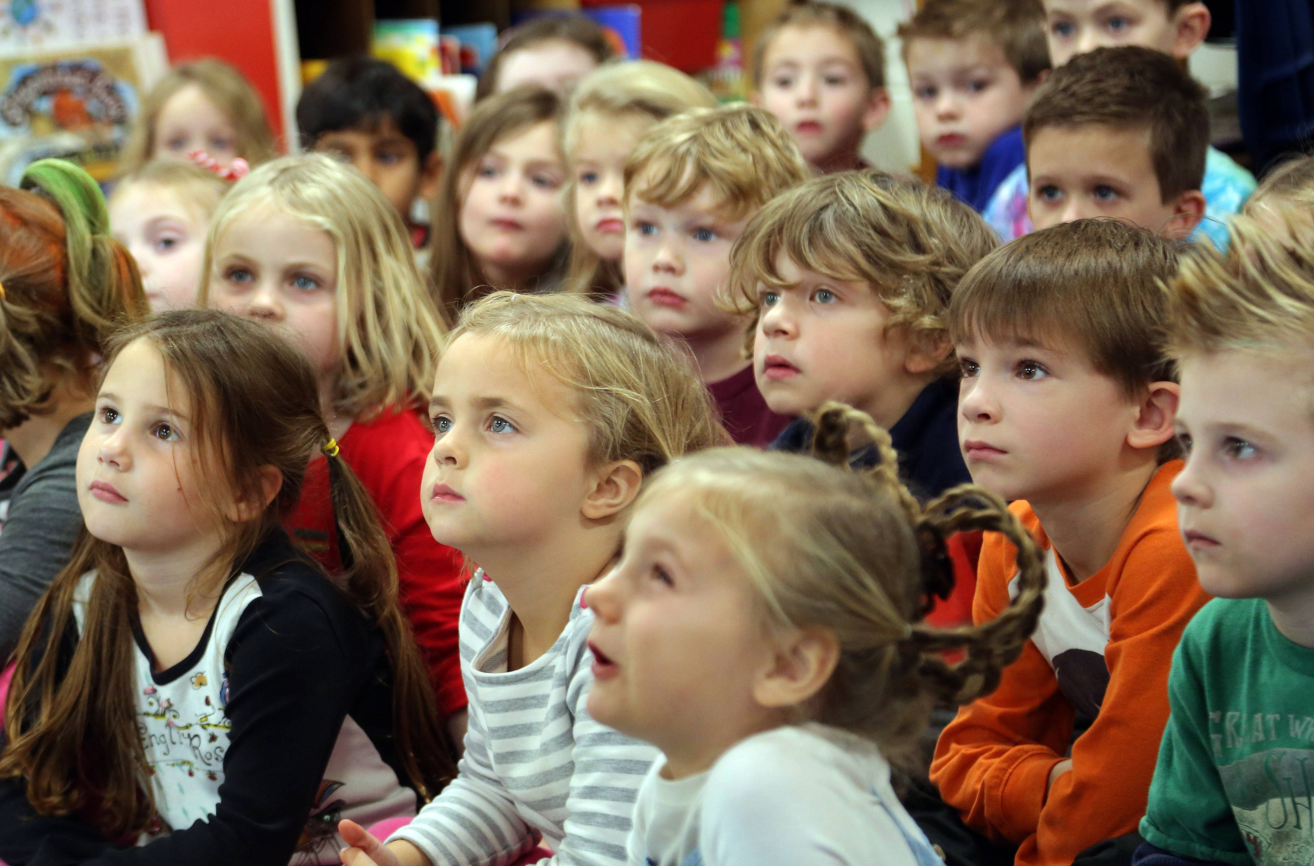 "Kindergarteners sit wide-eyed as District 70 Superintendent Dr. Guy Schumacher reads ""The Polar Express"" at Butterfield School in Libertyville Wednesday."
