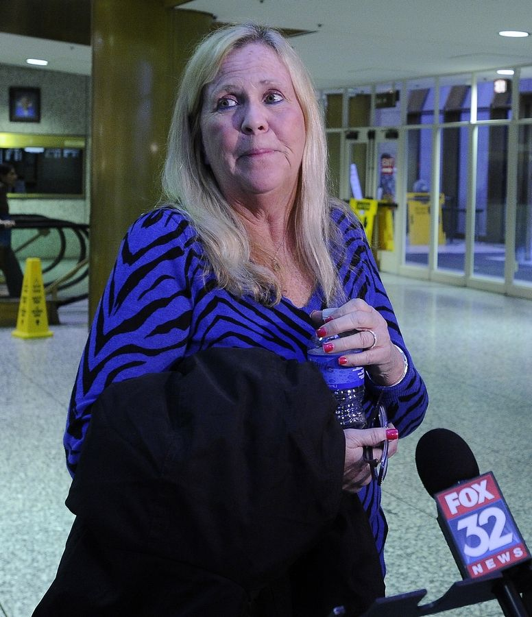 Cindy Mulligan of Barrington, Donnie Rudd's stepdaughter, talks about the charges against Rudd and the different sides of the man she knew before her mother's 1996 death from breast cancer. She was at the Cook County courthouse in Rolling Meadows Monday for Rudd's court hearing.