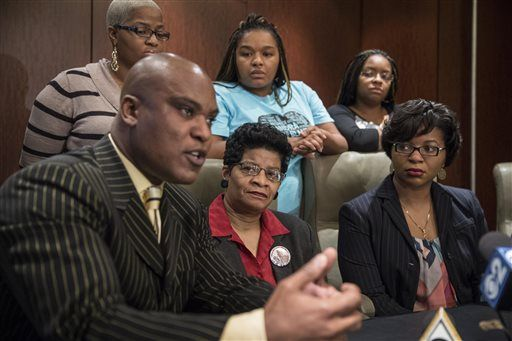 Cannon Lambert Sr., left, attorney for Sandra Bland's family, speaks at a news conference Monday, Dec. 21, 2015 in Chicago. Bland's family says they have no faith in a grand jury that's considering criminal indictments in her death in a Texas jail last summer. The family criticized the grand jury proceedings in Waller County, Texas. Lambert talks to reporters as Bland's sisters, standing from left, Shante Needham, Sharon Bland, and Sierra Cole join mother Geneva Reed-Veal, center, and sister Sharon Cooper, left. (Rich Hein/Chicago Sun-Times via AP) MANDATORY CREDIT, MAGS OUT, NO SALES; CHICAGO TRIBUNE OUT