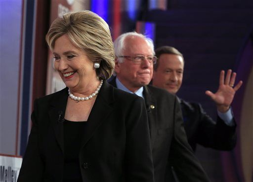 FILE - In this Saturday, Nov. 14, 2015 file photo, Democratic presidential candidates Hillary Rodham Clinton, Bernie Sanders and Martin O'Malley take the stage for a Democratic presidential primary debate in Des Moines, Iowa.
