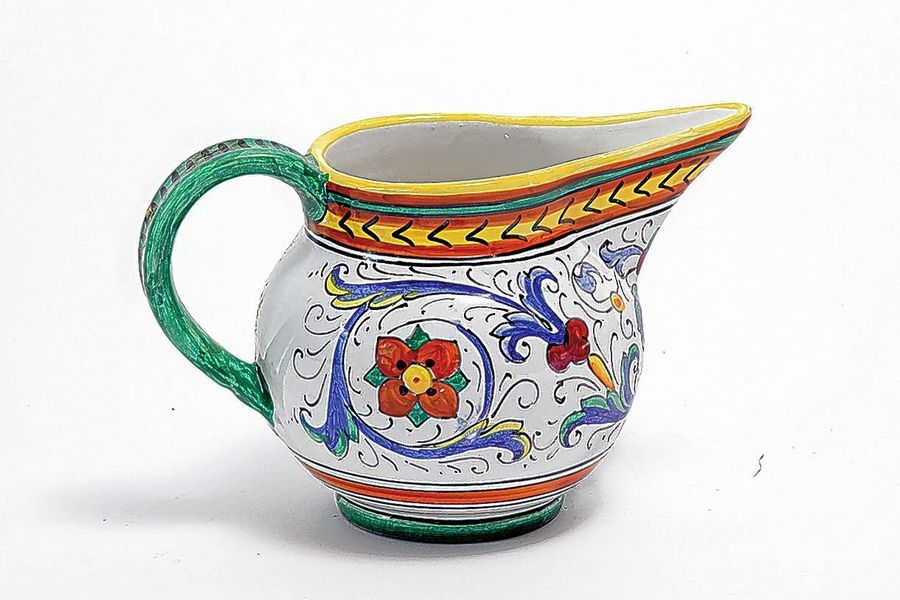 Deruta ceramics originated in southern Italy and are still being made today. You'll spot them in flea markets. The pitcher, here, and vase are recent versions and are valued at around $18.