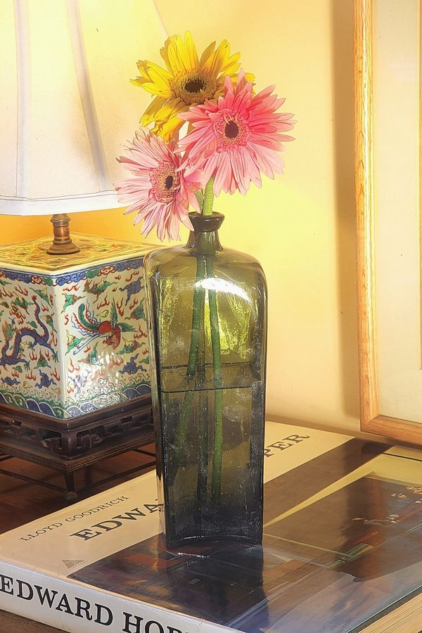 Slight imperfections indicate a case gin bottle was crafted by hand, increasing its desirability. This bottle, doubling as a vase, is valued at about $90.