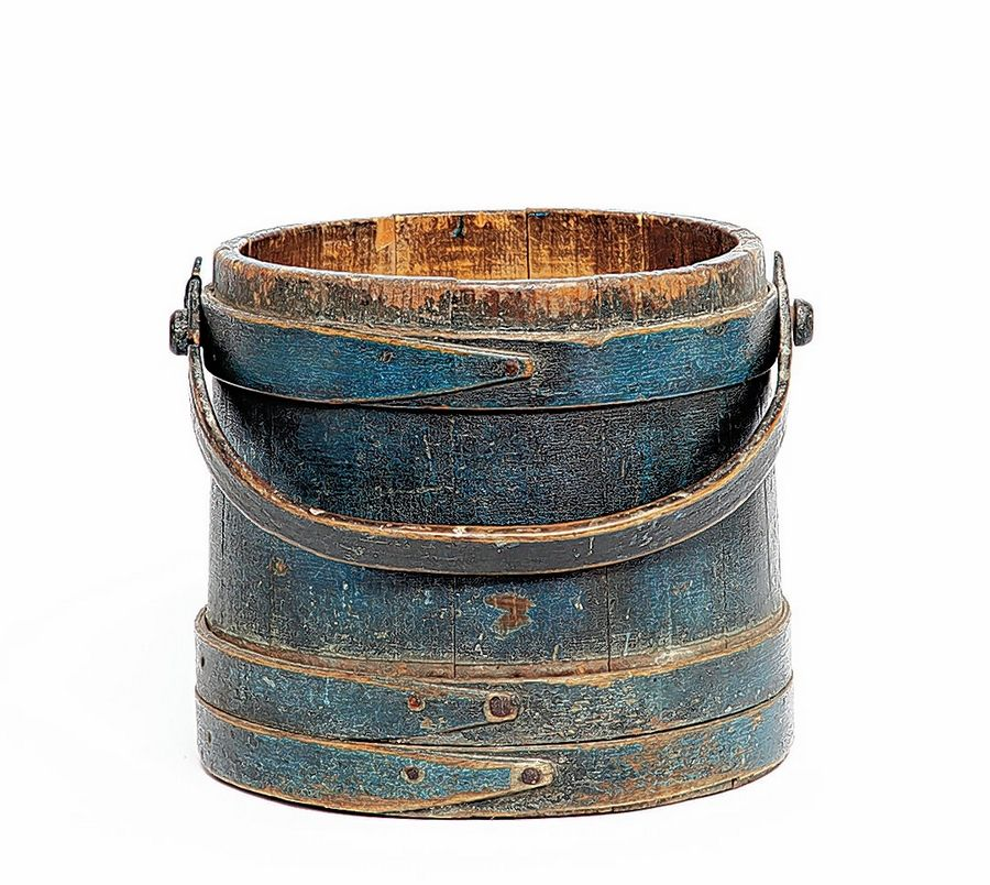 Barrel-shaped wood containers known as firkins are likely accessories in a Colonial home. They could store liquid (if lined with metal), or items like fish, sugar or grain. Painted with milkpaint, this lidless firkin would fetch about $85.