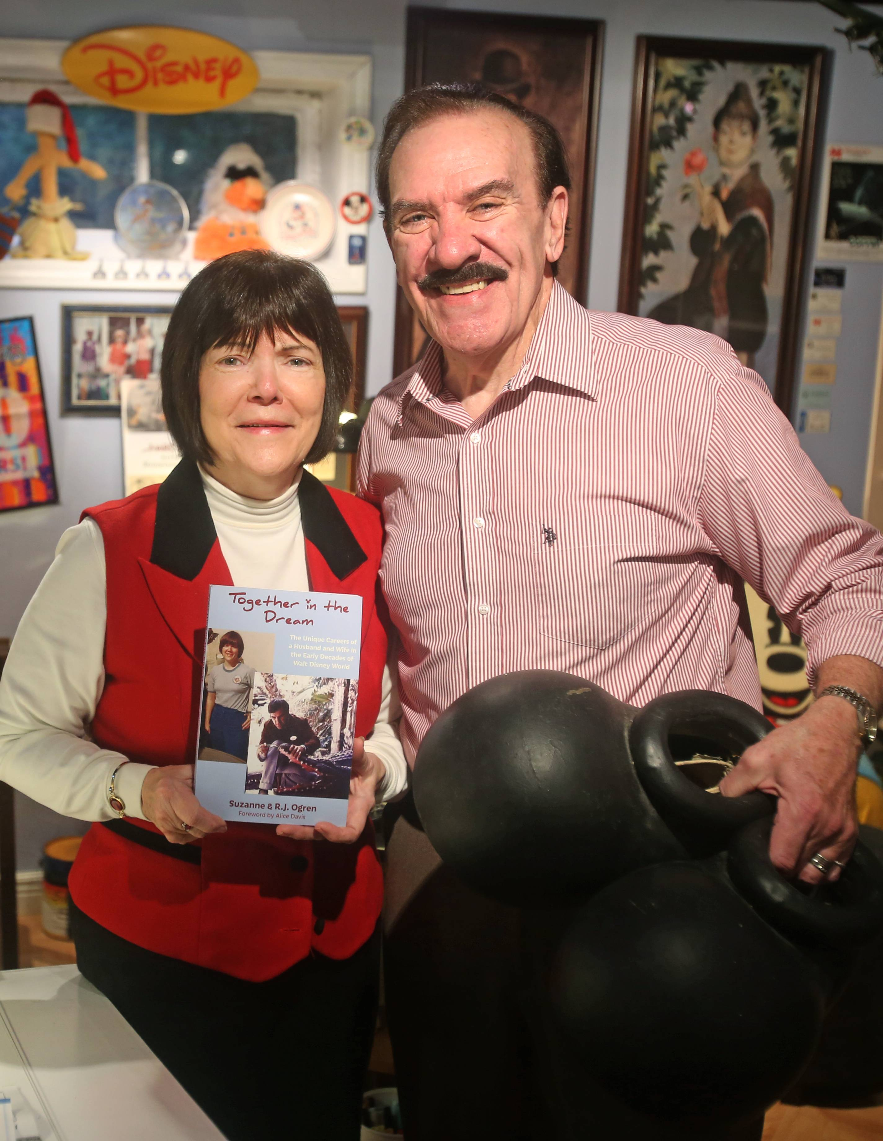 "Suzanne and RJ Ogren of Naperville share stories of working at Walt Disney World in the 1970s in their new book ""Together in the Dream."" The couple also has collected much Disney memorabilia, including the 1979 Mickey Mouse shoes RJ holds, which weigh several pounds each."
