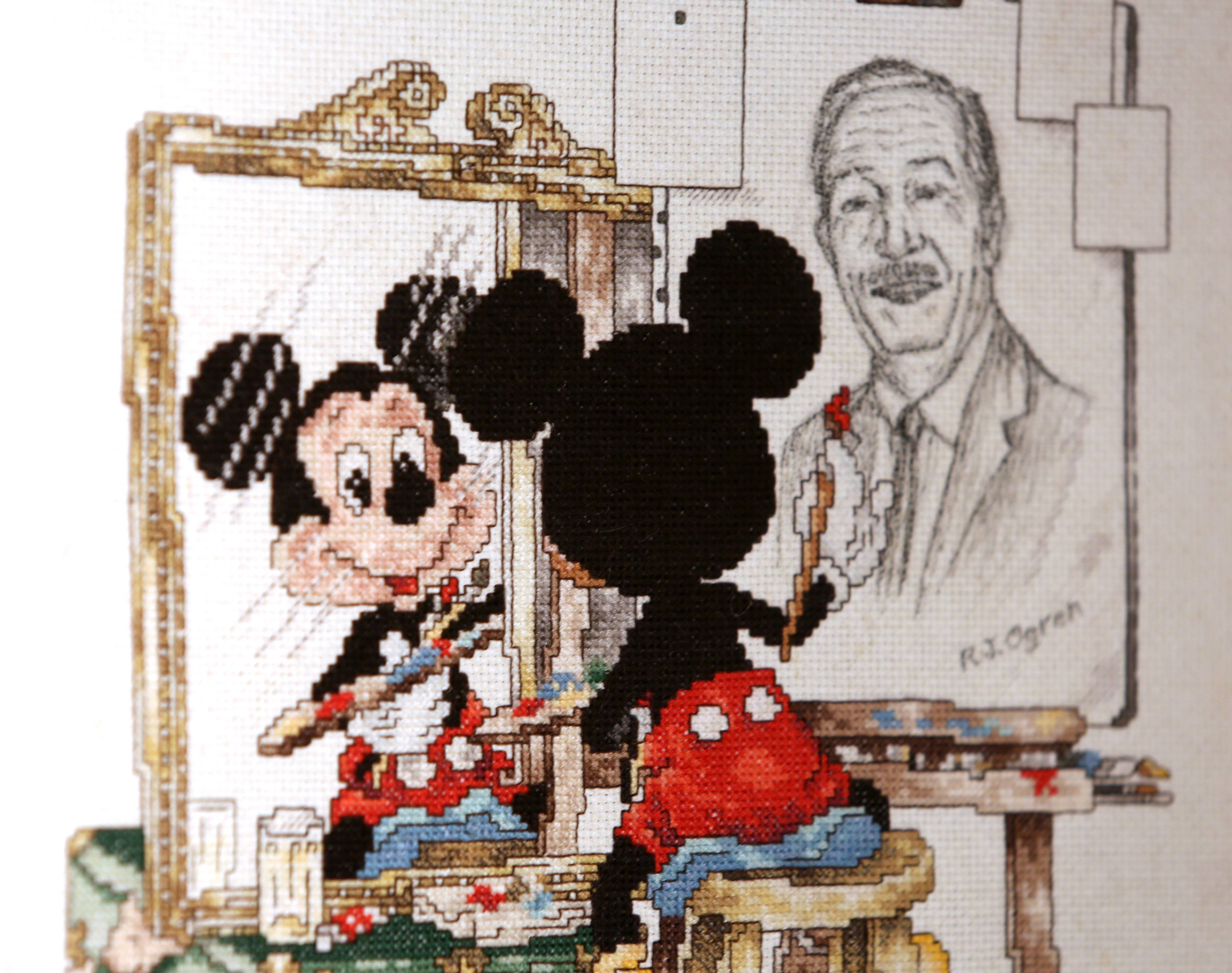 RJ Ogren, who has made a career out of Disney art, displays extensive Disney memorabilia such as this image of Mickey Mouse in the Naperville house he shares with his wife Suzanne.