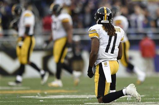 Pittsburgh Steelers wide receiver Markus Wheaton (11) kneels on the field after failing to catch a pass in the closing minutes of an NFL football game against the Baltimore Ravens in Baltimore, Sunday, Dec. 27, 2015. The Ravens defeated the Steelers 20-17.