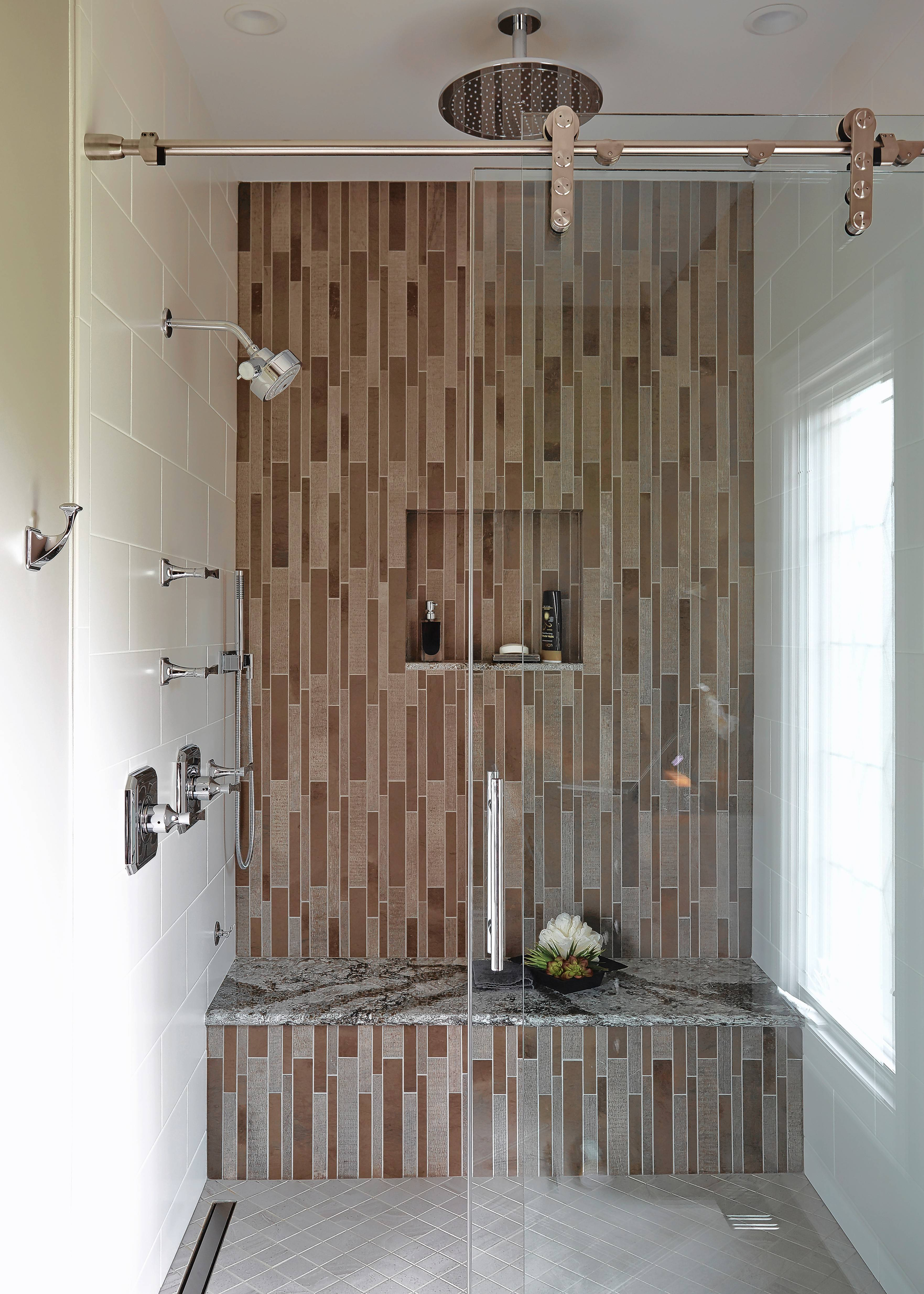 The rainfall showerhead in this walk-in shower is a favorite feature of homeowner Bill Frey.