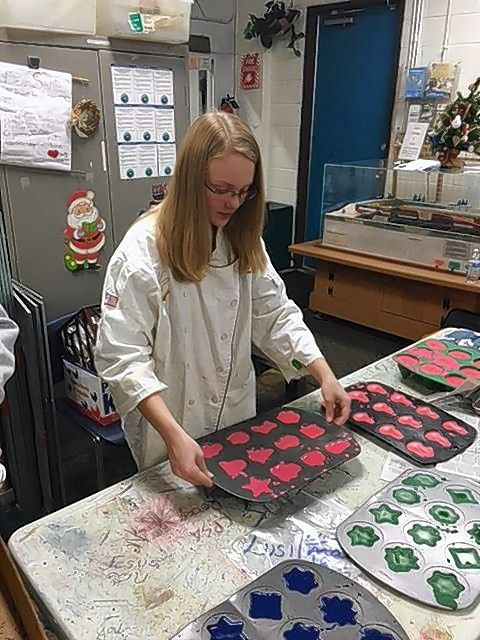 "Girl Scout Troop 50796 member Amanda Laurinec creates ""super Crayons"" at SCARCE in Glen Ellyn as part of her troop's Silver Award project."