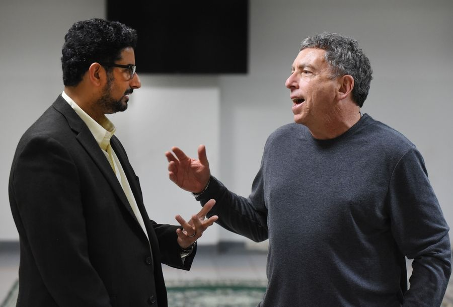 Azam Nizamuddin, co-chairman of the interfaith committee, meets with Barry Newman of Schaumburg during a rally Friday at the Islamic Foundation in Villa Park.