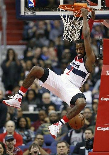 Washington Wizards Guard John Wall 2 Hangs On The Rim After His Dunk In