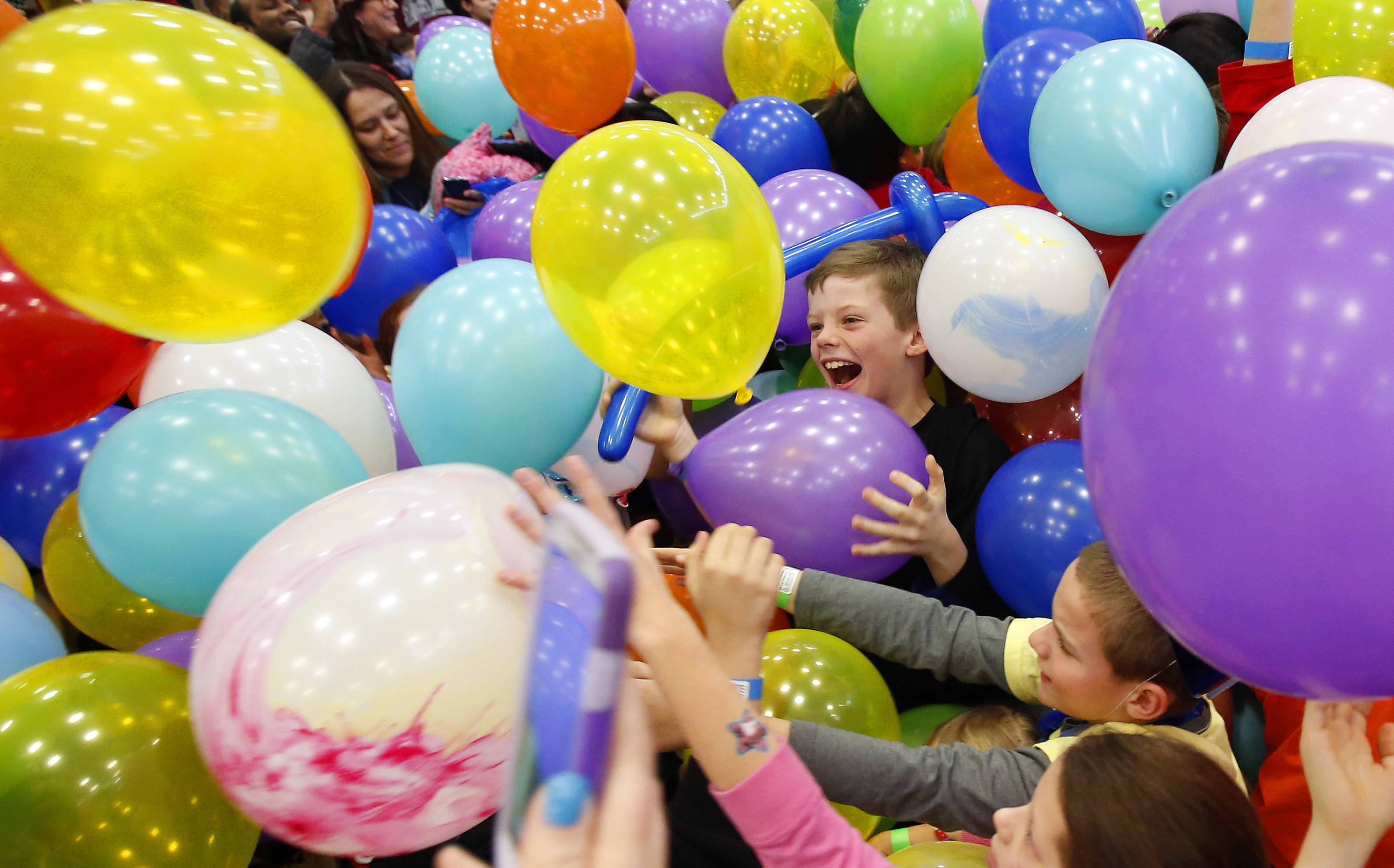 Nick Sieh, center, holding a purple balloon was among the estimated 750 kids and parents at the sixth annual Family New Year´s Eve Party at Vaughan Athletic Center in Aurora Tuesday.