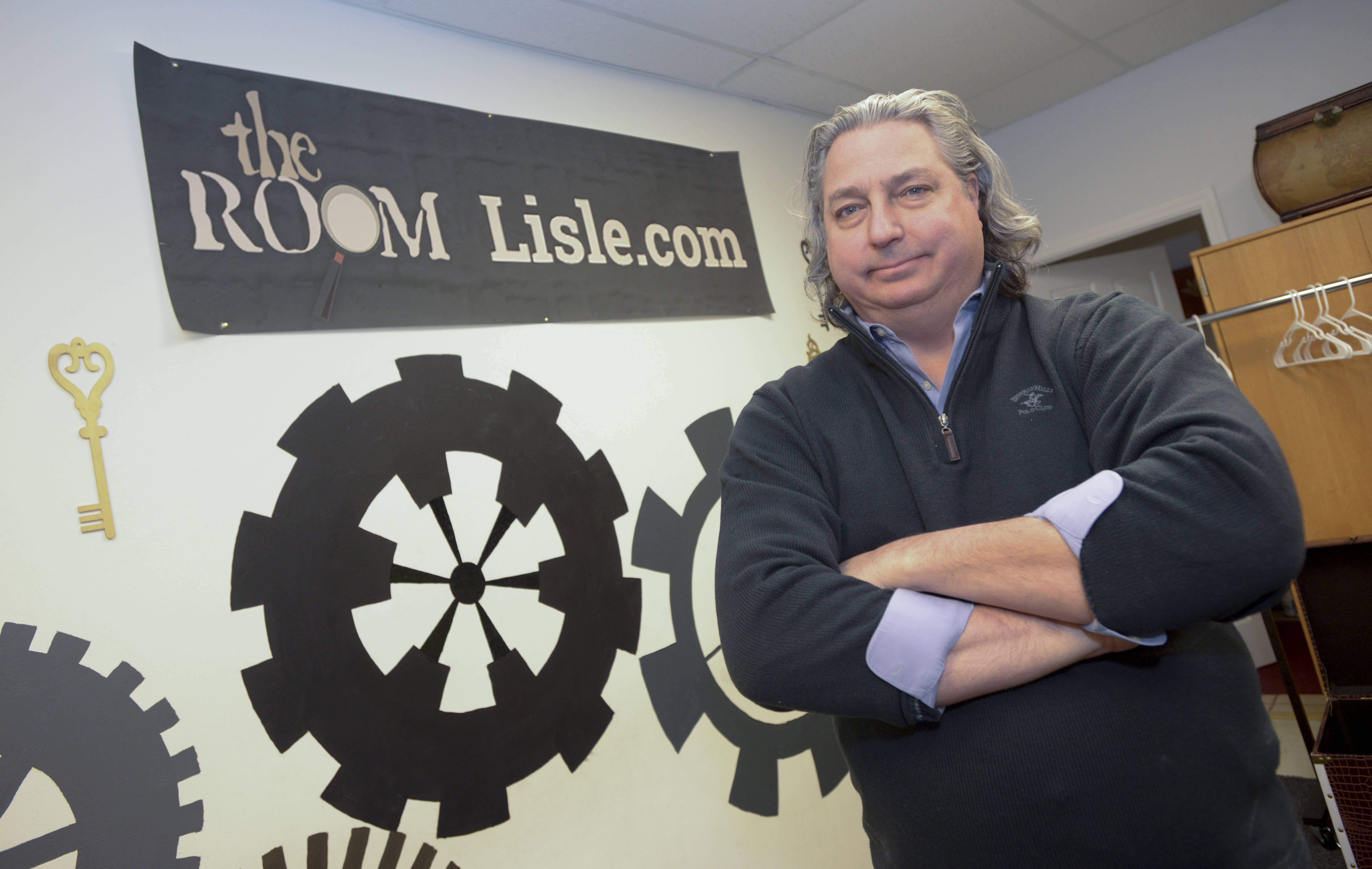"Dave Zajicek owns The Room in Lisle, one of several new ""escape rooms"" to pop up in the suburbs over the last 18 months."