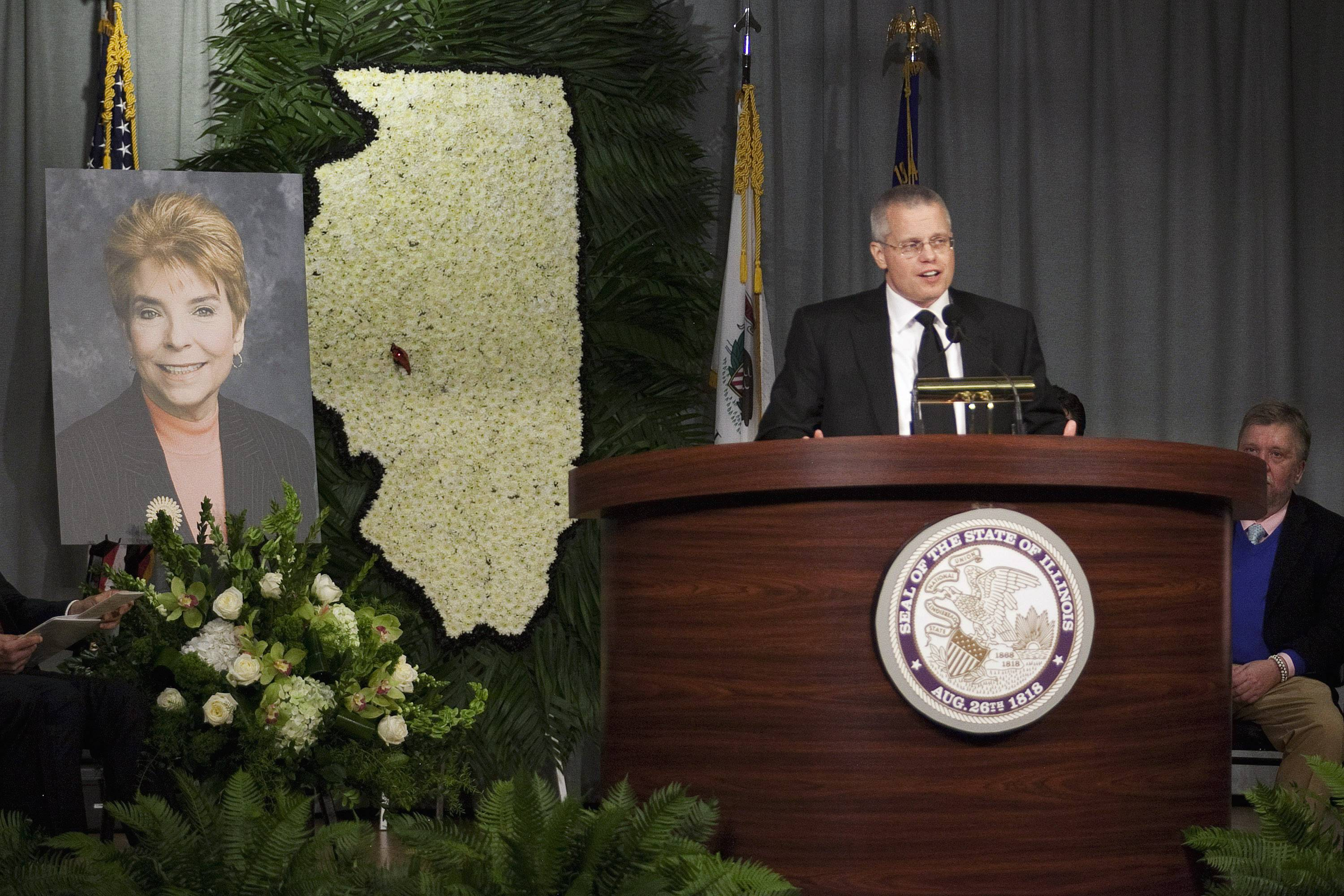 Joseph Topinka, son of late Illinois Comptroller Judy Baar Topinka, speaks during a public memorial for his mother in December 2014.