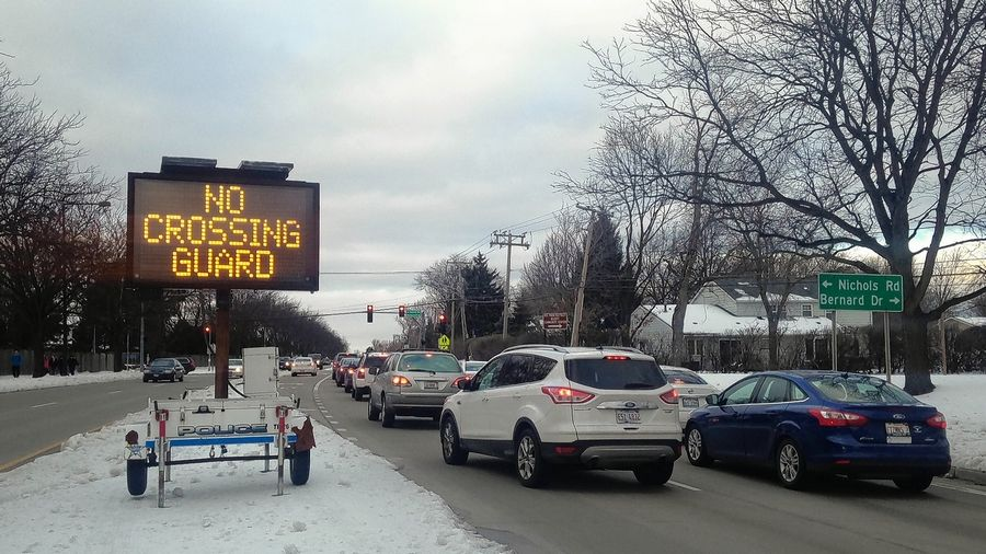 A sign along Arlington Heights Road reminds drivers traveling north that there is no crossing guard at the Bernard Drive intersection, where students cross to get to Longfellow Elementary and Cooper Middle schools in Buffalo Grove.