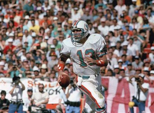 FILE - In this Jan. 20, 1985, file photo, Miami Dolphins quarterback Dan Marino scrambles during NFL football's Super Bowl XIX, against the San Francisco 49ers in Palo Alto, Calif. The San Francisco defense sacked the record-setting Marino four times in the game and held the Dolphins to 25 yards rushing.