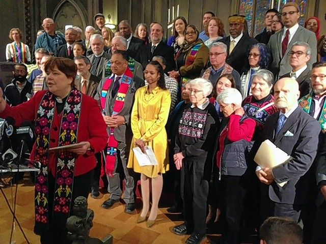 Wheaton College Professor Larycia Hawkins, in yellow, prepares to speak Wednesday in Chicago.