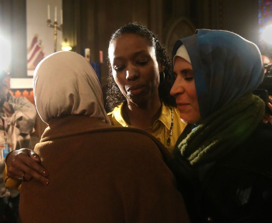 Larycia Hawkins, center, greets Lila Zegar and Fahima Abuzir of Orland Park after a news conference Wednesday in Chicago.