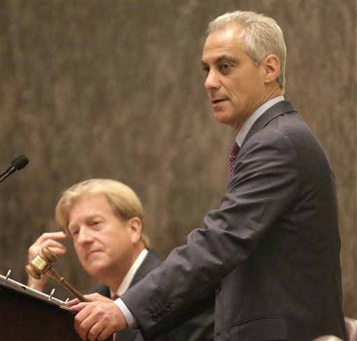 "In this Sept. 22, 2015 photo, Chicago Mayor Rahm Emanuel, right, accompanied by chief Corporation Counsel Stephen Patton speaks before the City Council, in Chicago. Mayor Emanuel says he has confidence in Patton, the head of Chicago's law department following the resignation of a top city attorney who was accused of hiding evidence in a fatal police shooting lawsuit. Emanuel said Tuesday Jan. 5, 2015, that chief counsel Patton is handling ""all the pieces"" when it comes to any possible review of cases."