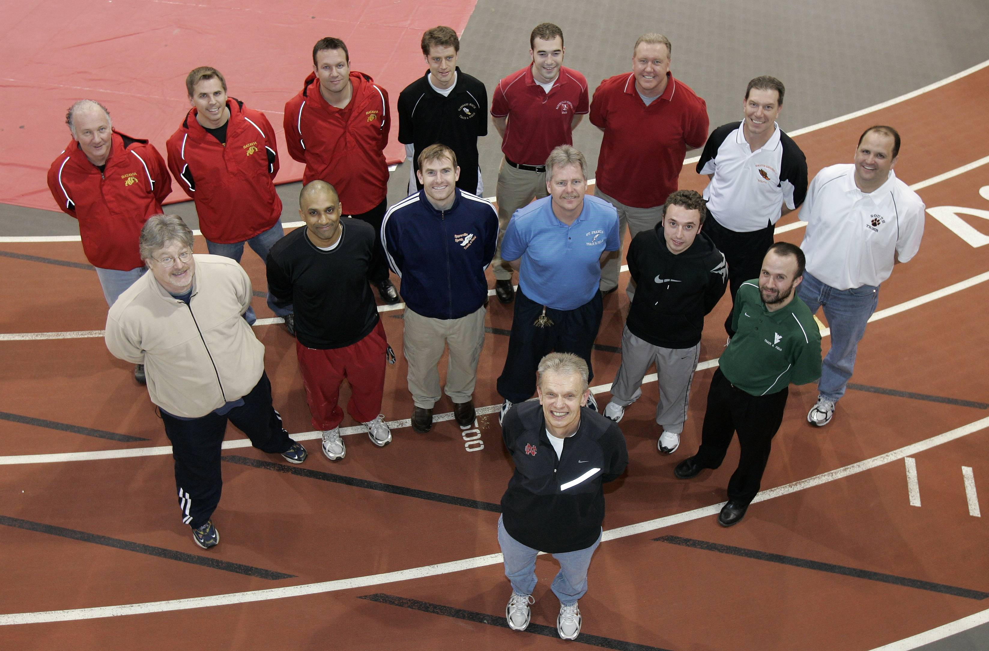 Local track coaches who are former athletes of lengendary North Central track coach Al Carius (BACK ROW) Chris Wheaton of Batavia, Chad Hillman of Batavia, Dennis Piron of Batavia, Jim Dickerson of Glenbard North, Dave Ashton of Naperville Central, Don Helberg of Wheaton North, Ken Helberg of Wheaton Warrenville South, Rob Harvey of Wheaton Warrenville South. (MIDDLE ROW) Tom Whitaker of North Central College, Mahesh Narayanan of North Central College, Chuck Hoff of Naperville North , Scott Nelson of St. Francis, Chris Bosworth of Lake Park and Kevin Rafferty of Waubonsie Valley. (FRONT ROW) Al Carius .