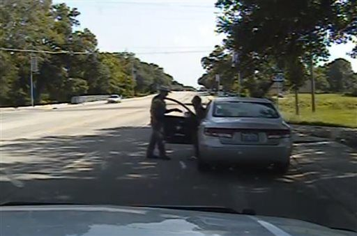 FILE - In this July 10, 2015, file frame taken from dashcam video provided by the Texas Department of Public Safety, Texas State Trooper Brian Encinia confronts Sandra Bland after a minor traffic infraction in Waller County,Texas. A grand jury indicted Encinia on Wednesday, Jan. 6, 2016, with the misdemeanor charge. Encinia has been on desk duty since Bland was found dead in her cell in July. Her death was ruled a suicide. (Texas Department of Public Safety via AP, File)