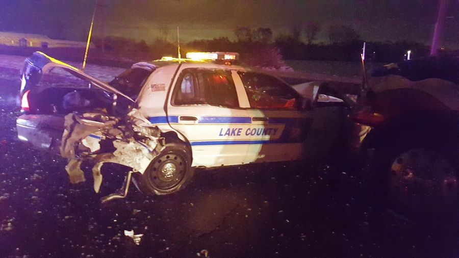A Lake County Sheriff's deputy was injured early Sunday after a Wauconda man accused of driving under the influence of drugs slammed into a patrol vehicle that had stopped to assist another driver, authorities said.