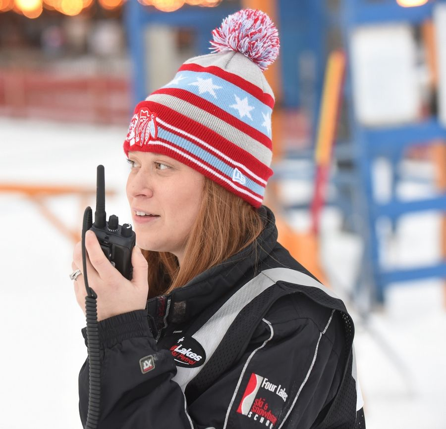 Kadee Korabik of Homer Glen calls the shots for the ski patrol recently at the Four Lakes Ski Hill in Lisle. She keeps an eye out for bad falls and rule breakers.