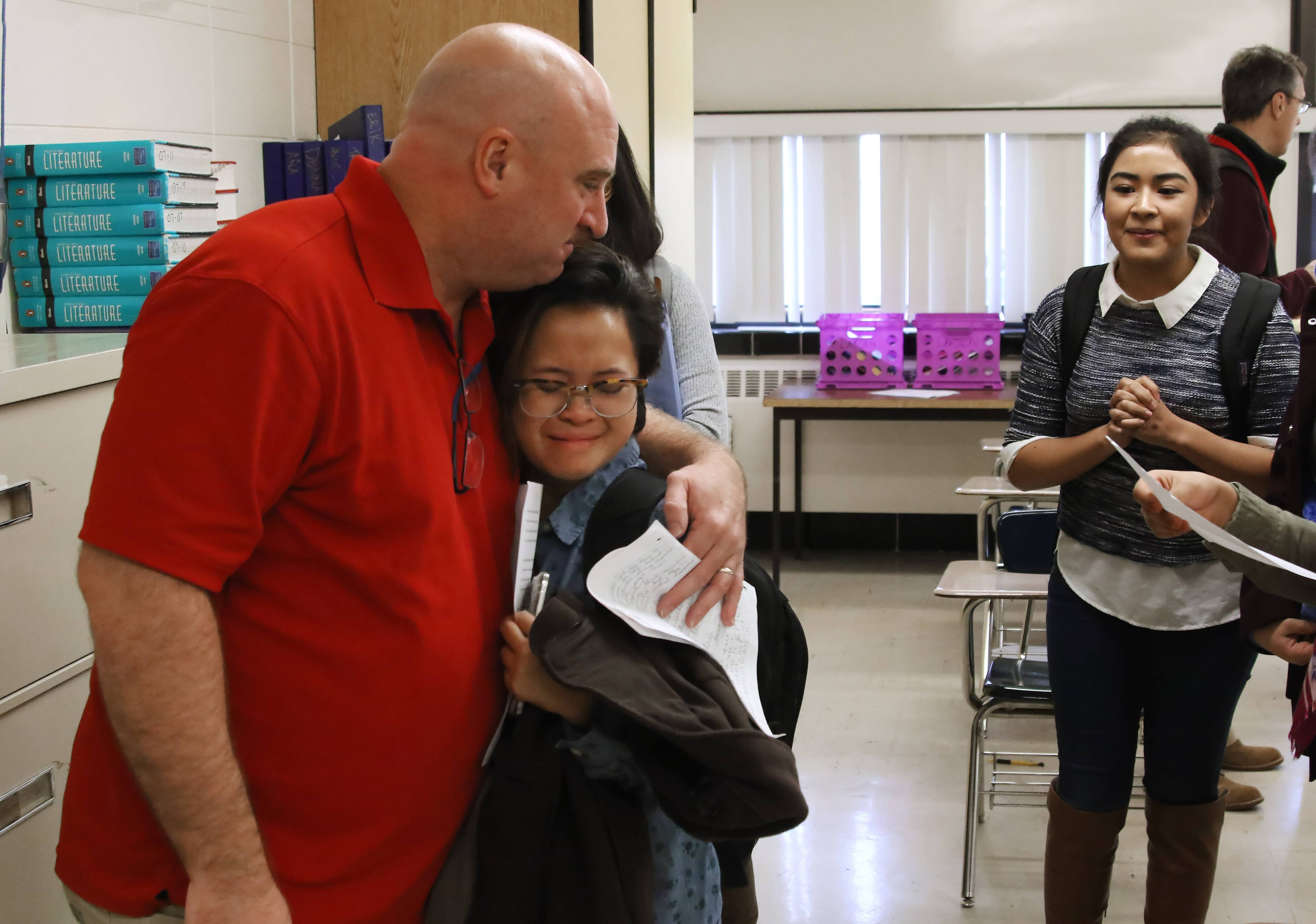Teacher Bob Diedrich hugs Angelica Torres as she cries about the poem she wrote in his Advanced Placement literature class at Round Lake High School.