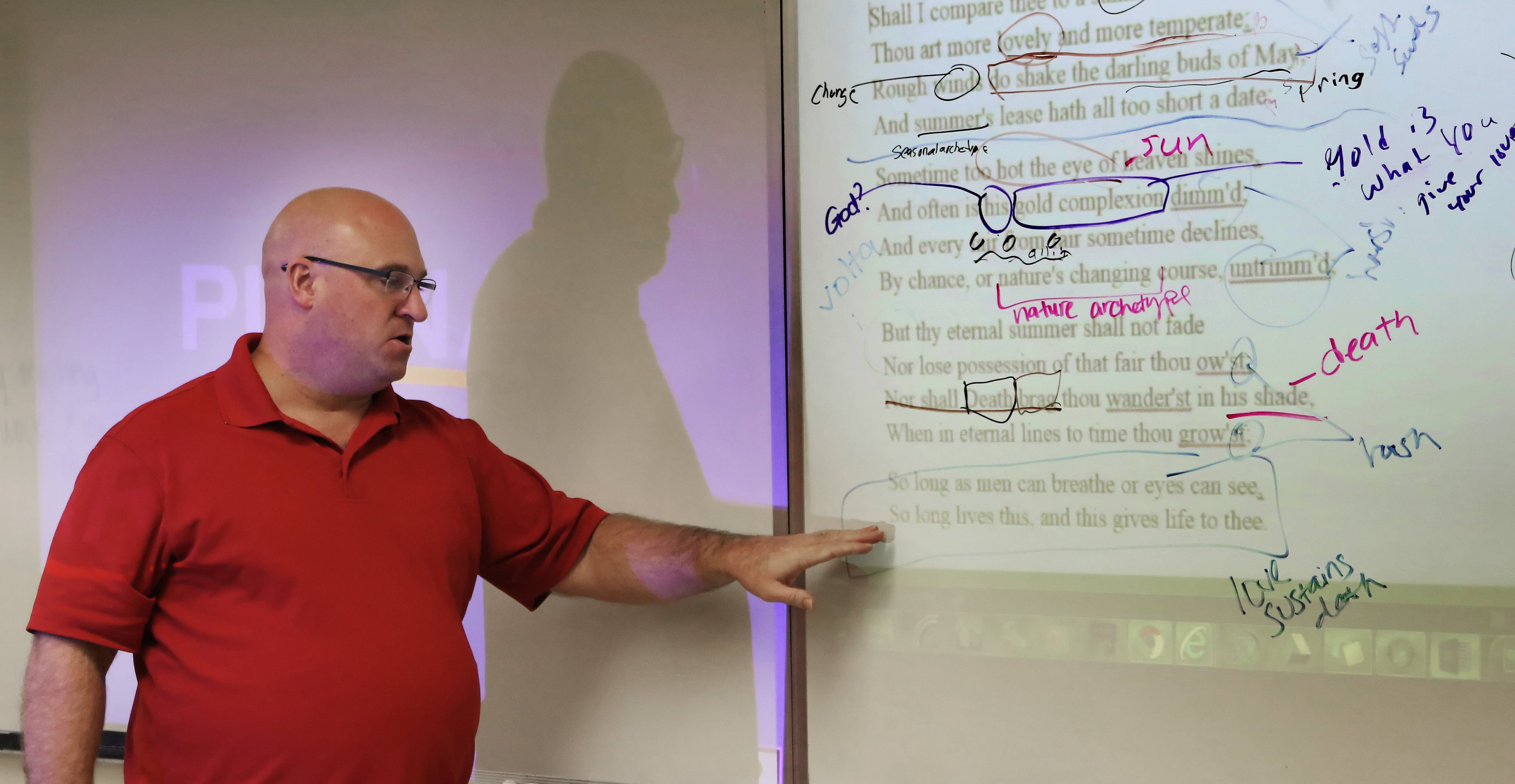 Bob Diedrich edits the construction of a Shakespearean sonnet as he instructs his Advanced Placement literature class at Round Lake High School.