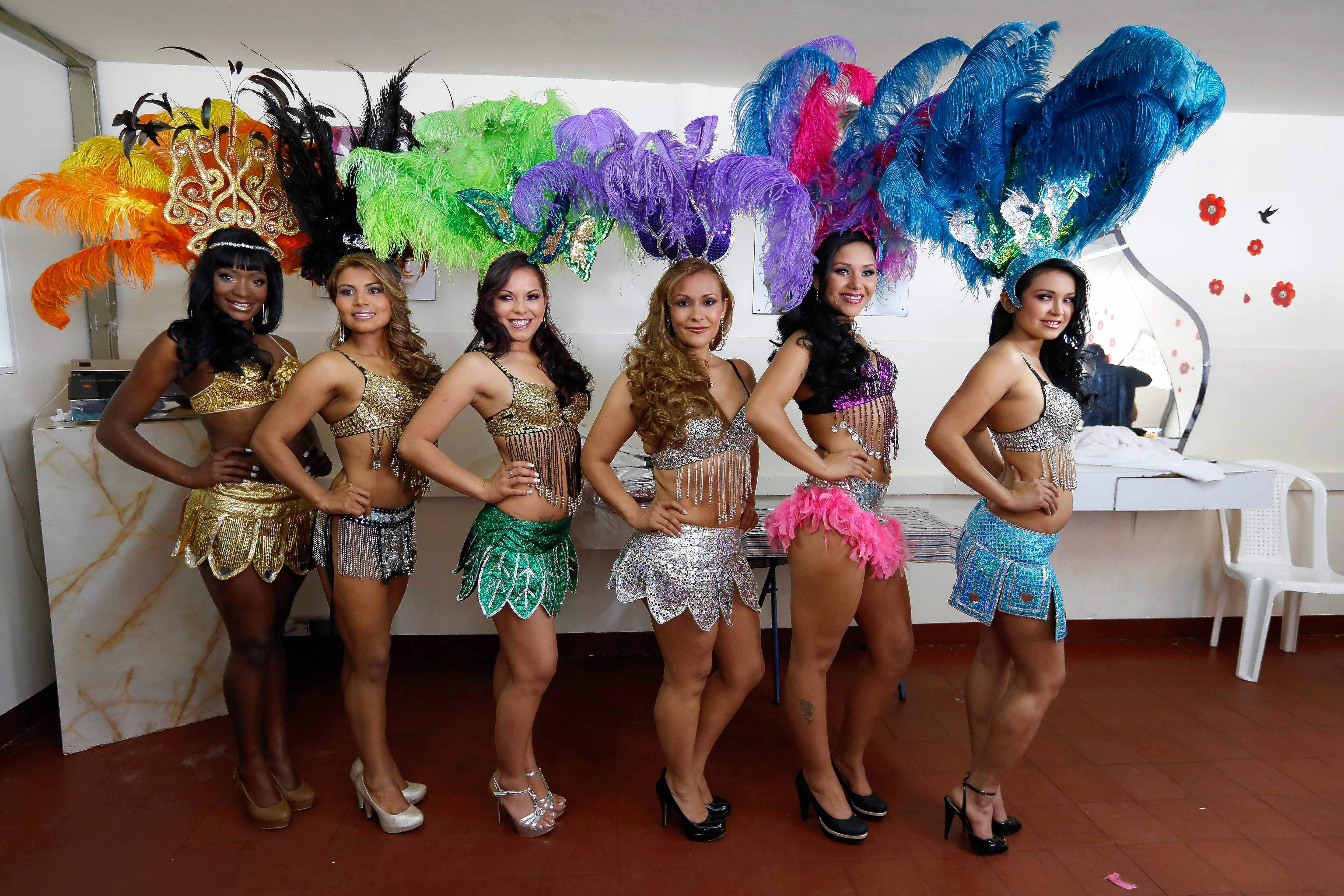 "Inmates strike a pose as they wait in line for the costume parade during a past beauty pageant at El Buen Pastor women's prison in Bogota, Colombia. The tradition inspired the play ""Another Word for Beauty,"" making its world premiere at Goodman Theatre."