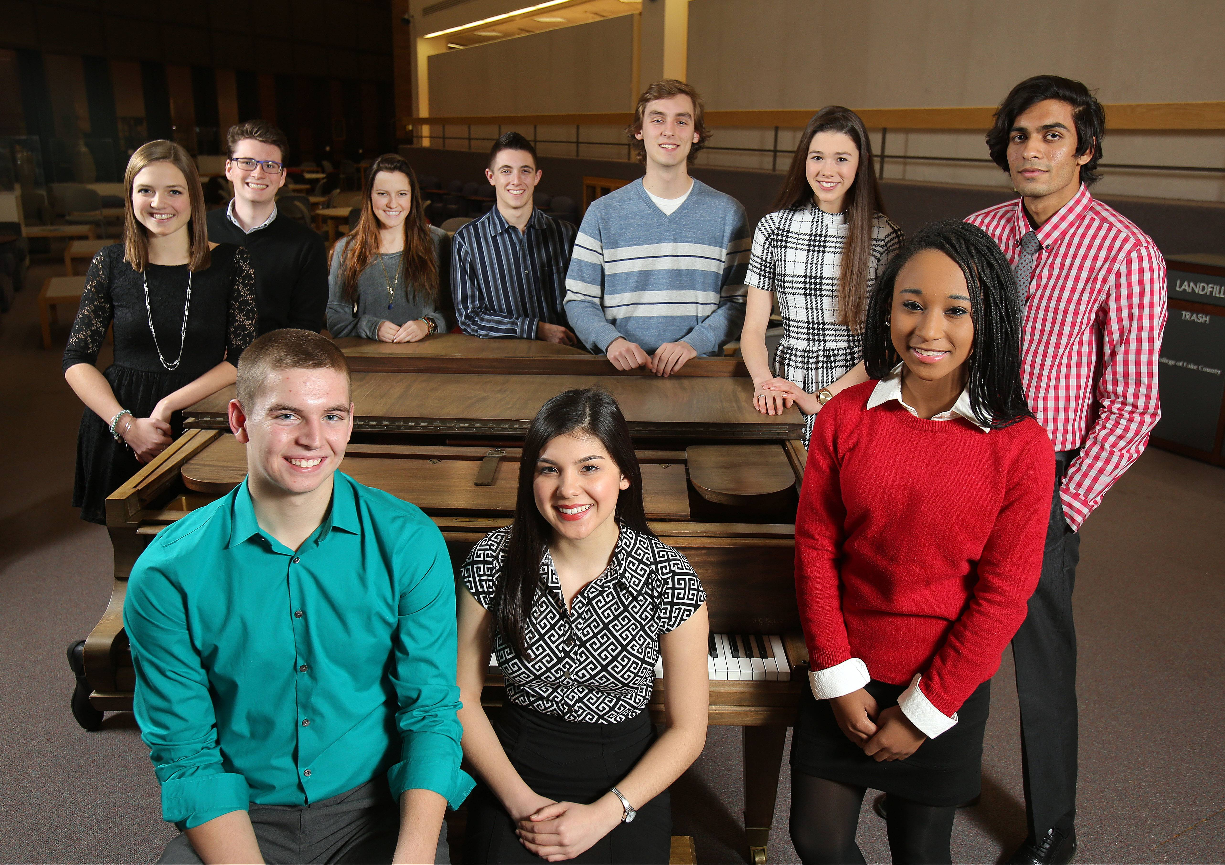 The 2015-16 Lake County Leadership Team gathers at College of Lake County in Grayslake. Behind the piano, from left: Meghan Fitzgerald, Grayslake Central High School; Connor Leden, Warren Township High School; Olivia Sorenson, Adlai E. Stevenson High School; Ben Panitch, Adlai E. Stevenson High School; Dan Marshalla, Lake Zurich High School; Eleanore van Marwijk Kooy, Woodlands Academy of the Sacred Heart; Marutinandan Dubey, Grayslake Central High School. In front of the piano, from left: Nathan Borries, Antioch Community High School; Vivian Margaret Lee, Mundelein High School and Nia McClendon, Libertyville High School.