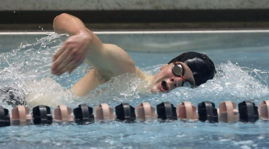 Stevenson's Topher Stensby wins the 200-yard freestyle during Thursday's meet against host Libertyville.