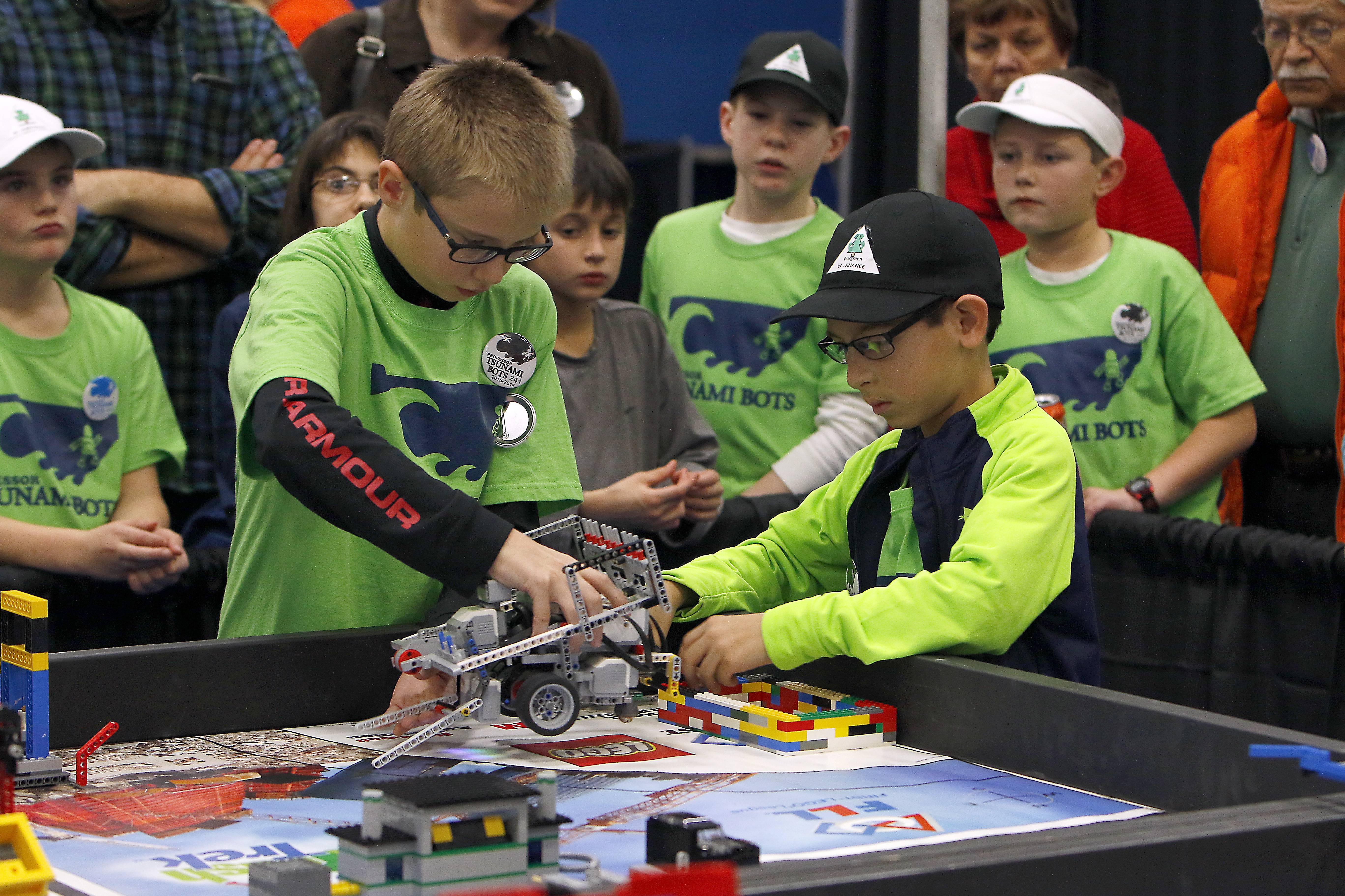 Aidan Fergus, 11, left and Sam Frusta, 11, both of St. Charles and team Tsunami Bots of the Fox Valley Robotics Club prepare their entry Saturday during the FIRST Lego state championship for northern Illinois is at Elgin Community College.