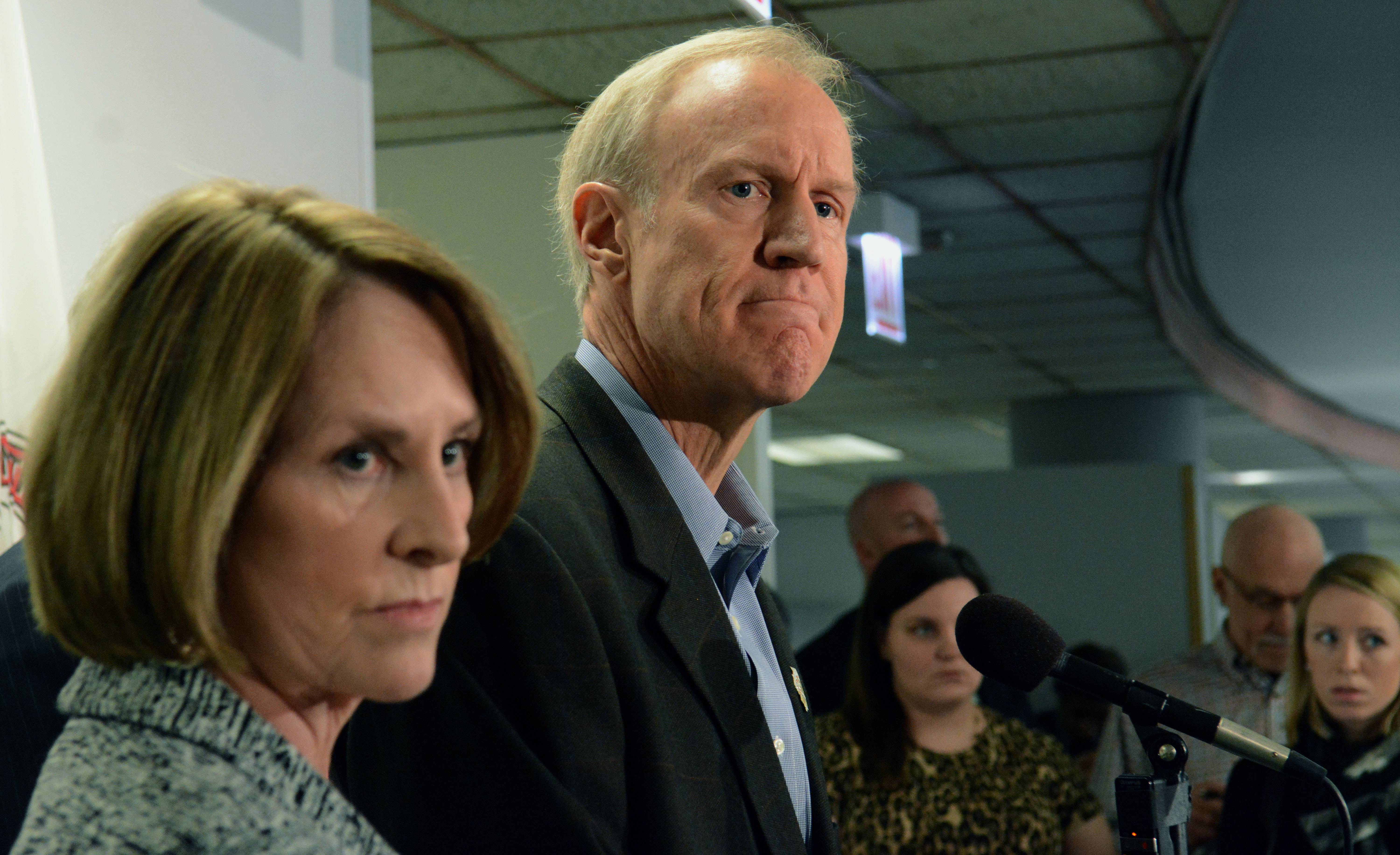 Gov. Bruce Rauner, with Sen. Christine Radogno, expresses support Thursday for a pension proposal giving public workers a choice of reduced benefits.