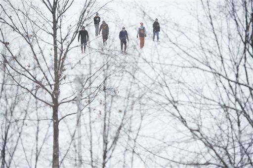 The Latest: Even Obama can't escape snowy commute