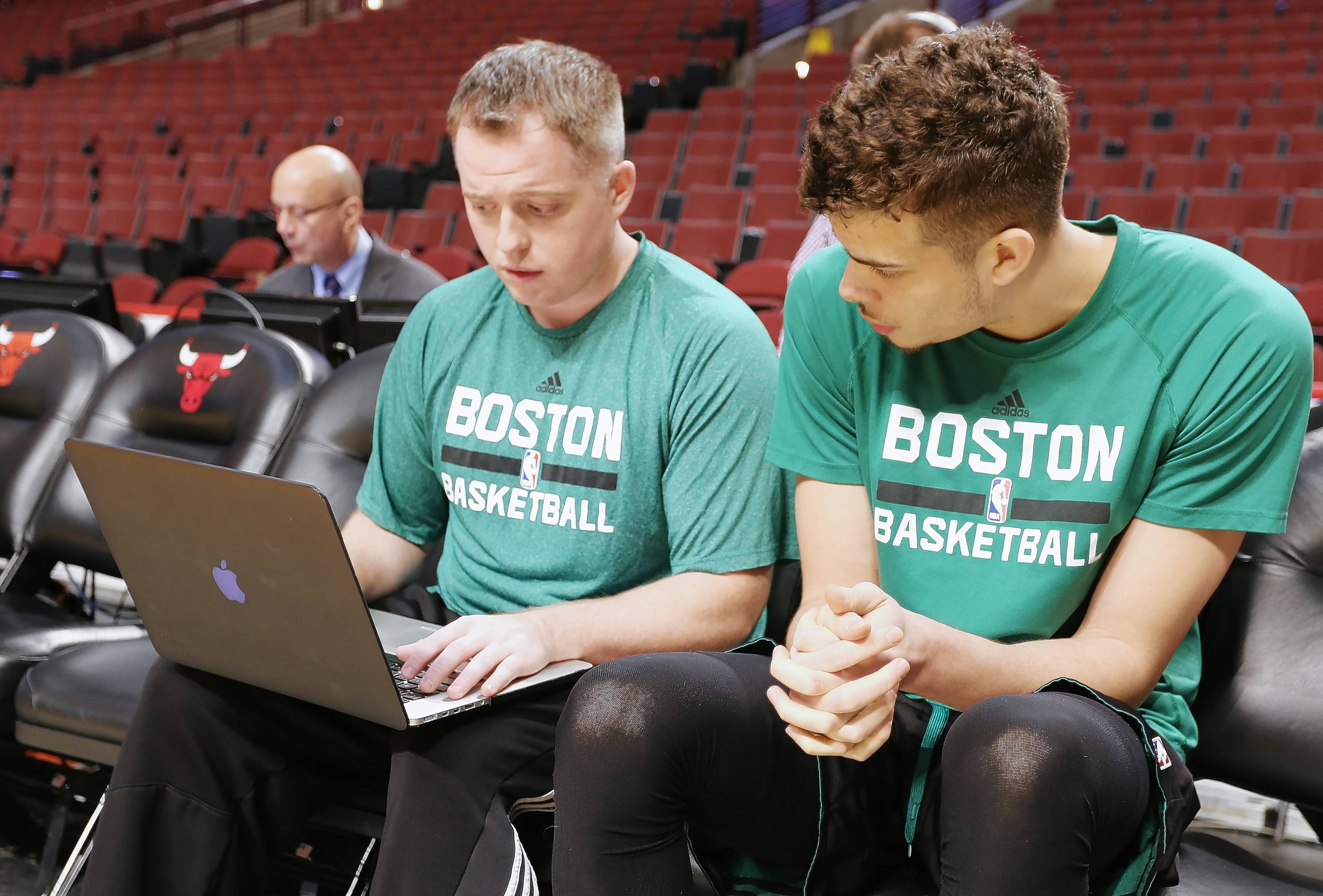 Brandon Bailey, left, of Mount Prospect, breaks down video and scouting reports for the Boston Celtics.